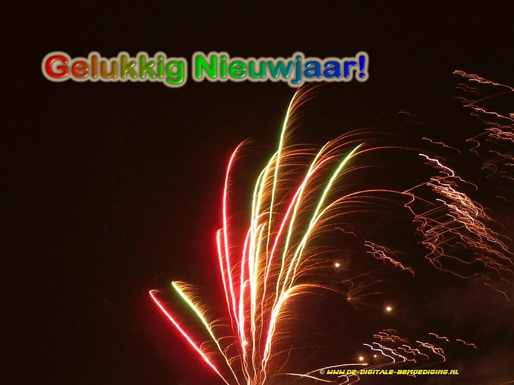 Gelukkig Nieuwjaar rood en groen vuurwerk